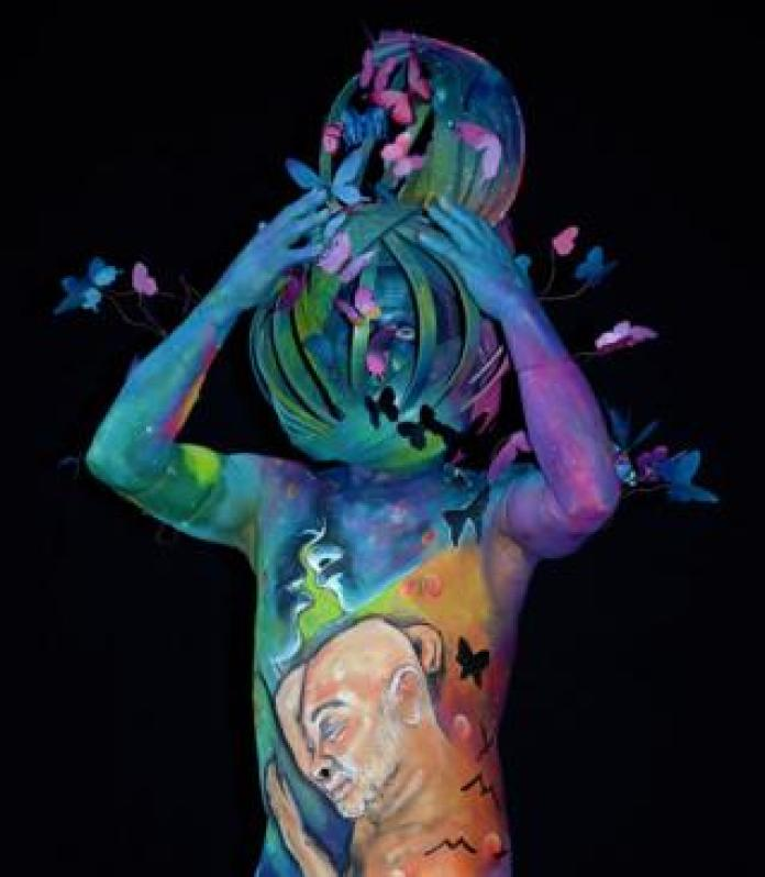 A model, painted by bodypainting artist Ton Nizet from the Netherlands, poses for a picture