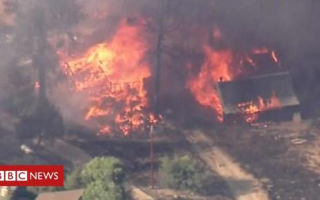 102717435 p06fv8rr - California wildfire tears through homes