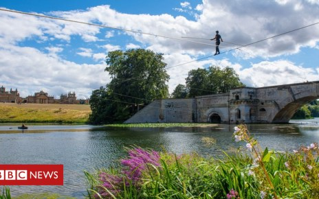 102951226 tightrope1 - Acrobat's 1,000ft tightrope walk over Blenheim Palace lake
