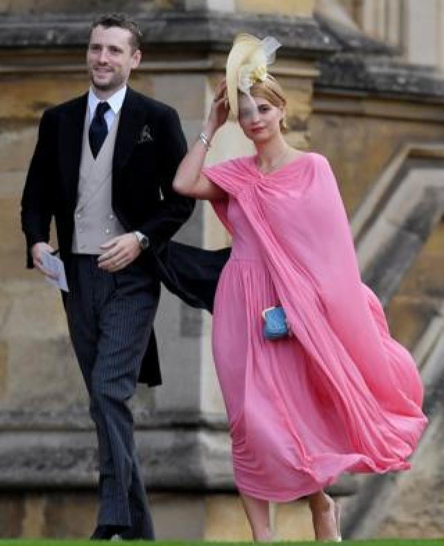 Guests Pixie Geldof and George Barnett arrive for the wedding of Princess Eugenie and Jack Brooksbank