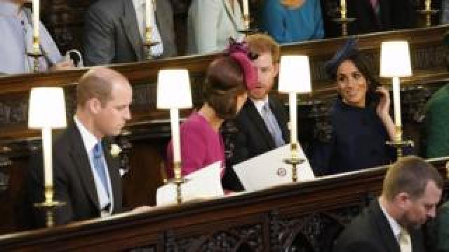 "The Duke and Duchess of Cambridge (left) and the Duke and Duchess of Sussex (right) take their seats ahead of the wedding of Princess Eugenie to Jack Brooksbank at St George""s Chapel in Windsor Castle. PRESS ASSOCIATION Photo. Picture date: Friday October 12, 2018. See PA story ROYAL Wedding. Photo credit should read: Danny Lawson/PA Wire"