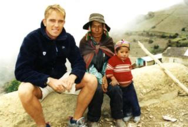 Simon Thomas with one of the children the stamps will help in Peru