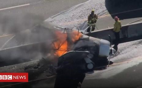 104009091 p06pqd7y - Plane bursts into flames on US motorway