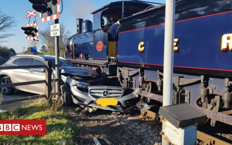 104383746 train - Steam engine hits car at Sheringham level crossing
