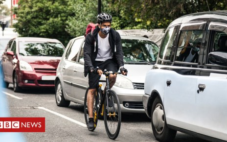 104437525 cyclistcar getty - Cycling awareness plan could lead to cheaper insurance for drivers