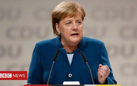 104688563 merkelcduthisafp - Germany's Merkel bids emotional farewell to CDU party