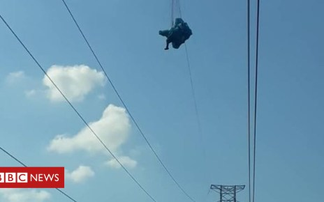 104716491 capture2 - Tangled Venezuelan paraglider rescued from power lines