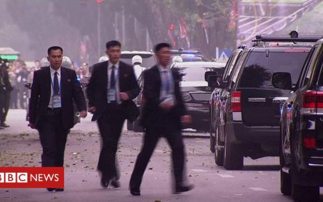 105834679 p07264y0 - Kim Jong-un's security team in dash for cavalcade