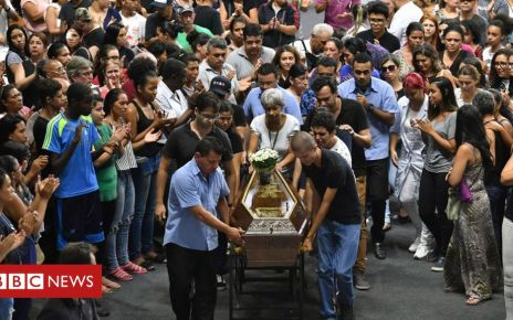 106031054 mediaitem106031050 - Brazil school shooting: Thousands attend wake for victims