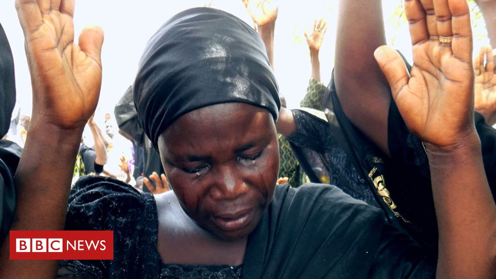 106438557 afp parentscrying976 - Letter from Africa: Why Chibok parents turning to TV 'miracle' pastor to find daughters