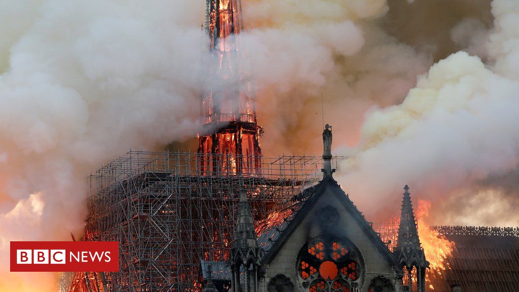106463831 hi053452539 - Notre-Dame fire: Flames 'have completely engulfed the roof'