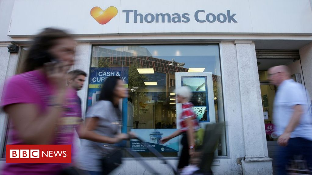 104613323 thomascookshopafp - Thomas Cook says Brexit hitting holiday plans