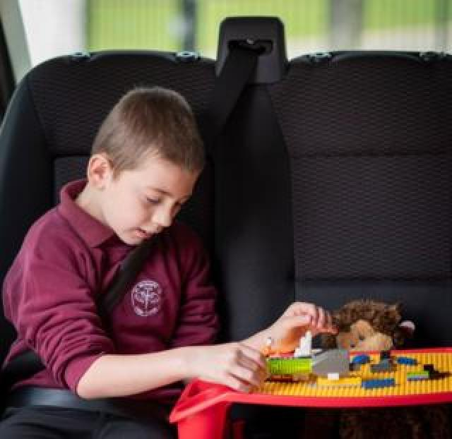 Jordan creates a scene out of Lego, with a teddy bear next to him