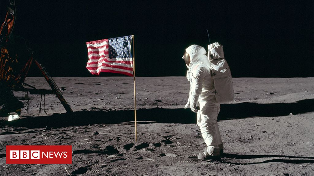 106909524 buzz salutes the u.s. flag - NASA Moon mission: Open University partners with space agency
