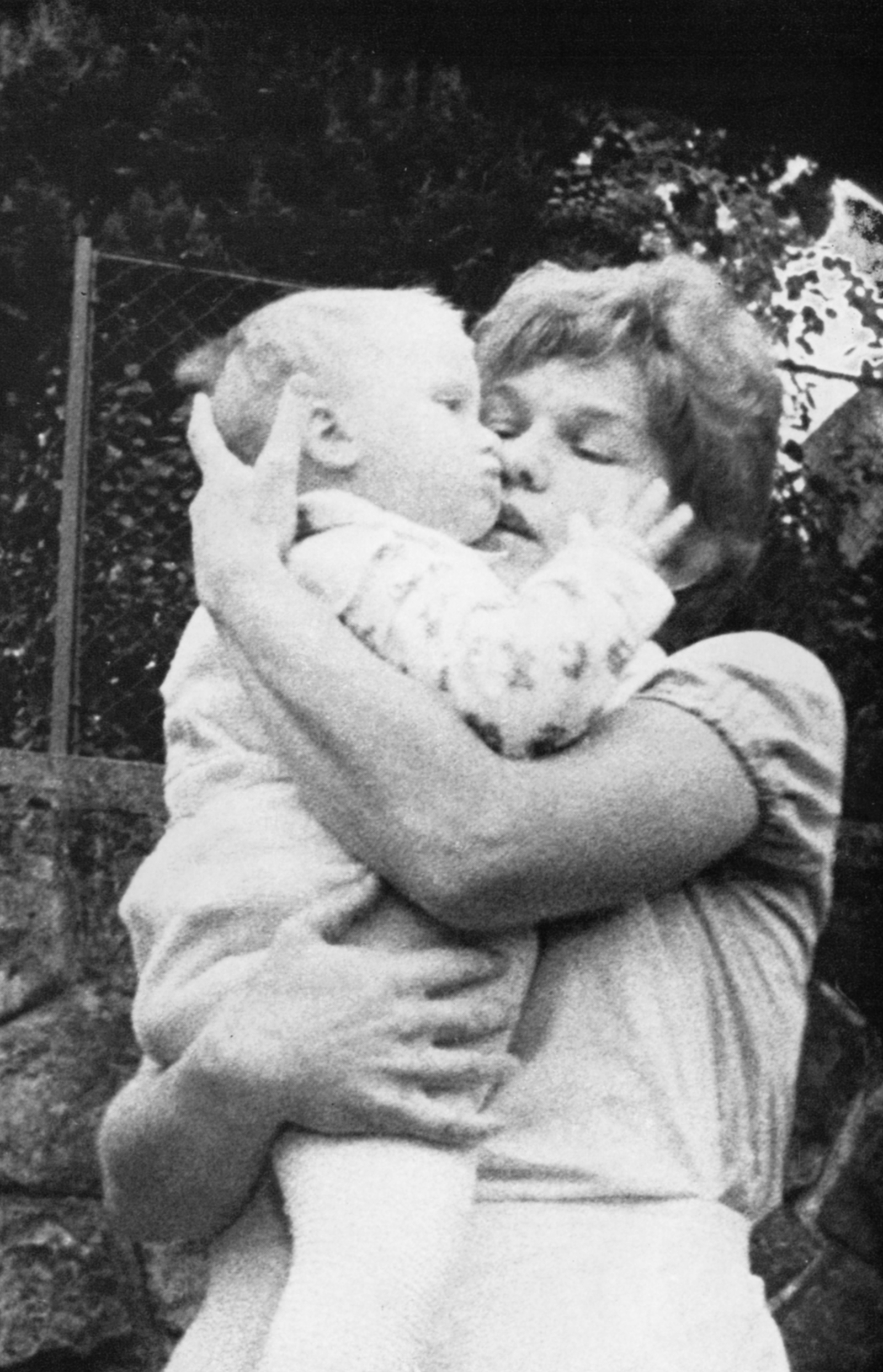 A woman with a baby in her arms