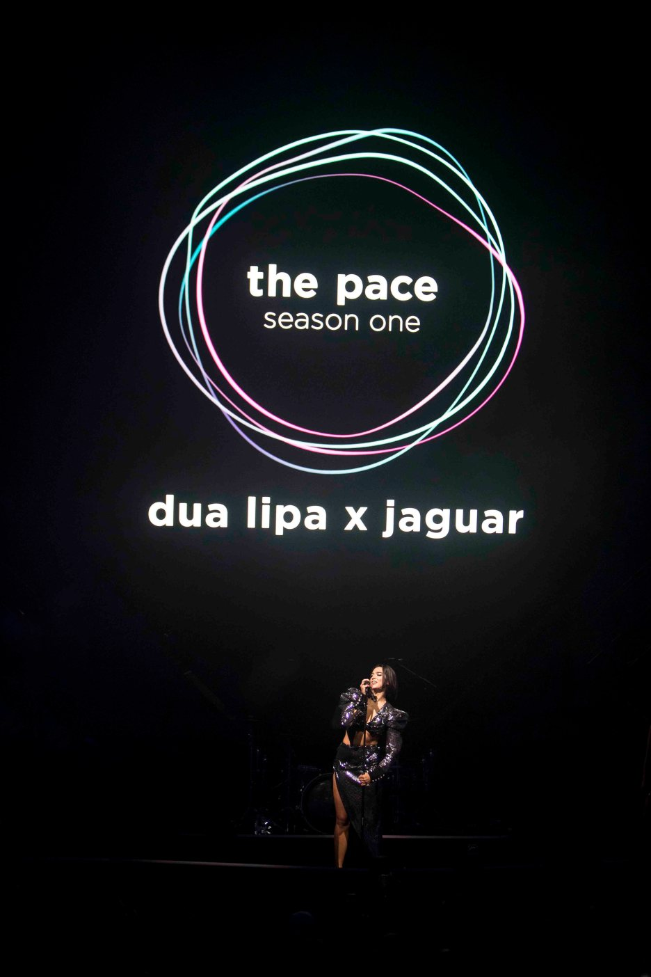 Jaguar and global superstar singer-songwriter Dua Lipa launch pioneering tech and music collaboration with live performance of exclusive remix of unreleased track, Want TO {PACE Remix} – created by utilising innovative technology from the Jaguar all-electric I-PACE - at Sugar City in Amsterdam, Netherlands. Fans can personalise their own version of Dua Lipa's latest track Want TO {PACE Remix} at remix.jointhepace.com, from data captured by the all-electric I-PACE, through Spotify, or by tapping a rhythm on a mobile. #thepace #jaguar