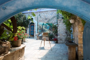 Safed is a city in the Northern District of Israel. Located at an elevation of 900 metres (2,953 ft), Safed is the highest city in the Galilee and of Israel.Due to its high elevation, Safed experiences warm summers and cold, often snowy, winters. Since the sixteenth century, Safed has been considered one of Judaism's Four Holy Cities, along with Jerusalem, Hebron and Tiberias; since that time, the city has remained a center of Kabbalah, also known as Jewish mysticism.The picture shows the courtyard of an art gallery in Safed colorful lanes. Photo by Itamar Grinberg.
