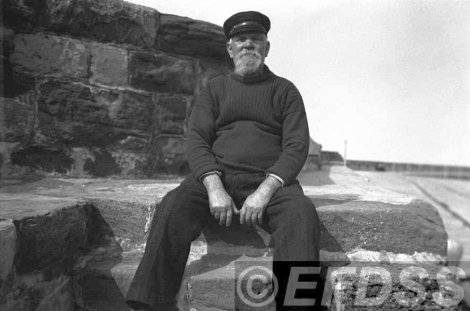 John Short, otherwise known as Yankee Jack, sitting on the breakwater at Watchet