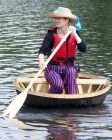 Claudia Myatt and her coracle