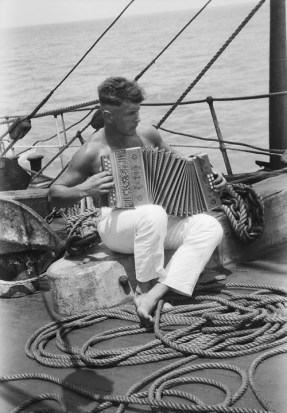 A sailor and his accordion onboard the Parma