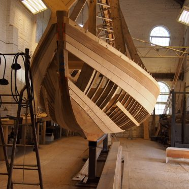 Photos from the Purifier Building – a John Welsford Joansa and the apprentices' replica of the Mayhi
