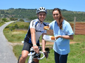 Reach for a Dream PE branch manager Michelle van Huyssteen  (right) gives young cyclist Mathew Allen a taste of The Herald VW Cycle Tour's new Dream Mile. The spectator point on the Lake Farm climb provides the ideal vantage point from which to enjoy the 106km Classic on Sunday, February 2. Photo: Sam Majela