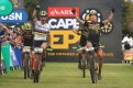 Nino Schurter and Matthias Stirnemann of SCOTT-SRAM MTB Racing celebrate winning stage five and taking the overall lead during stage five of the Cape Epic. Photo: Shaun Roy/Cape Epic/SPORTZPICS
