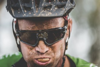 A photo of a rider grabbing a quick bite to eat along the joBerg2c day two route. Photo: Em Gatland