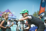 A young spectator offers a participant some water on the joBerg2c route. Photo: Em Gatland