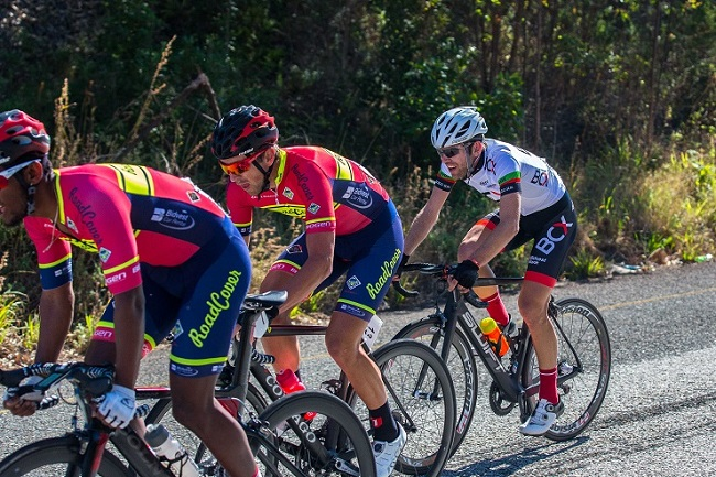 RoadCover's Clint Hendriks (right) and Brendon Davids (centre) in the company of BCX's David Maree during the Bestmed Jock Classic road cycling race that started and finished in Mbombela, Mpumalanga, on Saturday.