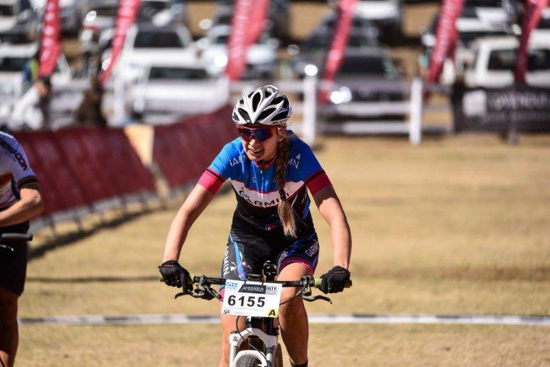 An image of Yolandi du Toit crossing the finish line on the second day of the National MTB Series in Dullstroom, Mpumalanga, today.
