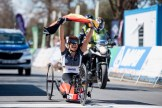 Hands held high, Andrea Eskau celebrates her win at the Para-cycling Road World Championship. Photo: Andrew McFadden