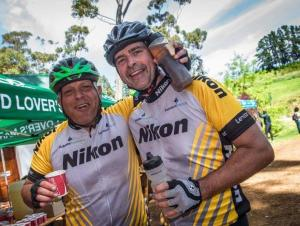 An image of two riders enjoying the delicious treats on offer at one of the waterpoints on stage two of Wines2Whales Race.