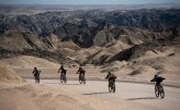 Riders scattering about with a magnificent mountainous backdrop. Photo: Gondwana Collection Namibia