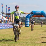 Julian Jessop crossing the line at the Karkloof Classic with Stuart Marais following in the distance. Photo: Anthony Grote