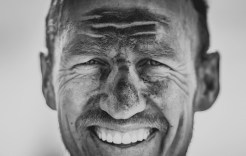 A close-up of a rider's dirty face after day one of sani2c Adventure