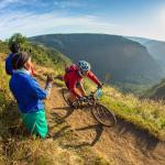 A spectator cheers on a rider on day two of sani2c Trail.