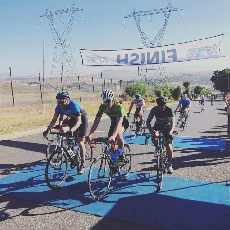 Riders crossing the finish line at the 99er Cycle Tour