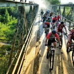 A bunch of riders pictured moving across a bridge on stage five of the TransCape MTB Encounter. Photo: Jacques Marais