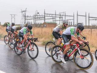 A group of riders moving along a wet and slippery section of the road during stage one of the Tour of Good Hope. Photo: Henk Neuhoff Photography