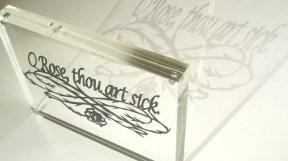 O Rose, thou art sick. Papercut in acrylic block frame.