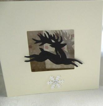 Reindeer with vintage paper