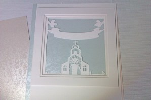 Papercut with powder blue broderie background