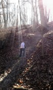 A steep portion of the trail is backlit by the Saturday sun at McNaughton Park.