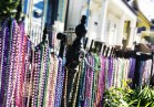 Shortly after Mardi Gras 2013, beads still adorn a fence along Magazine Street in the Garden District.