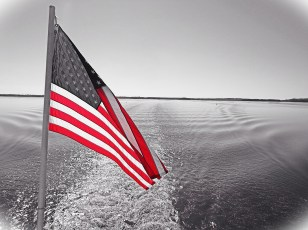 "An American flag flies from the stern of the riverboat ""Twilight"" while cruising from Le Claire, Iowa, to Dubuque, Iowa."