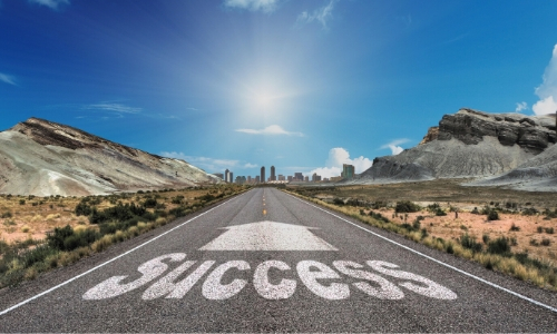 road with the word success