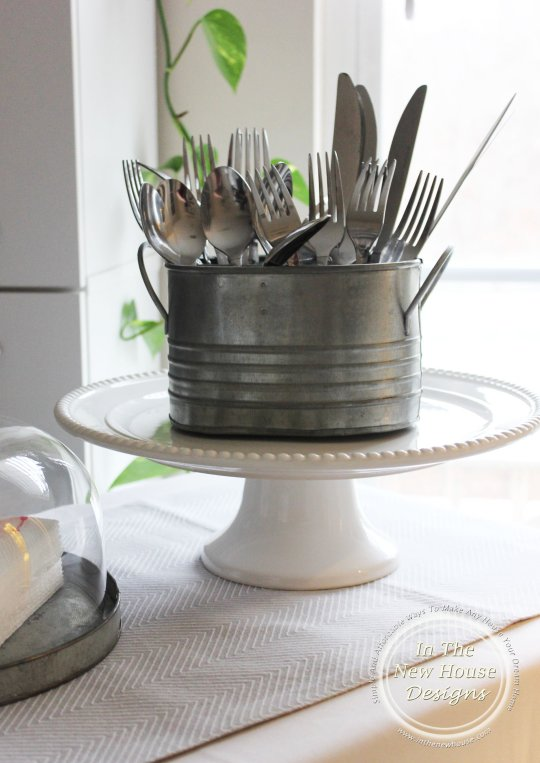 Silverware caddy on a cake stand makes the perfect addition to a buffet