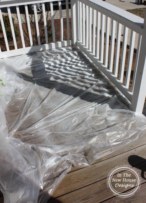 Cover deck floor with plastic to prevent splatters