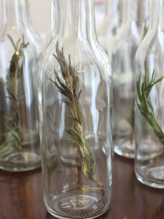 Insert Rosemary Sprigs into bottles